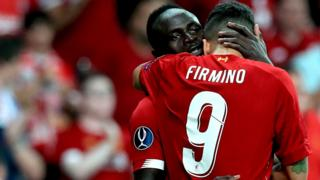 Mane and Firmino celebrate Liverpool's goal