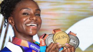 British athlete Dina Asher-Smith with her World Championship medals