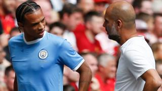 Leroy Sane talks to Pep Guardiola after coming off after 13 minutes of the Community Shield against Liverpool
