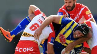 Warrington's Chris Hill tackled by a number of Saints players