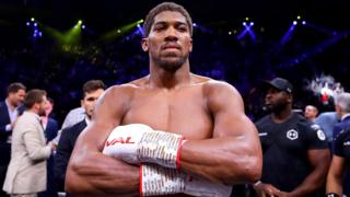 Heavyweight champion Anthony Joshua poses with his arms crossed after beating Andy Ruiz Jr in Saudi Arabia