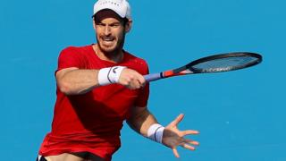 Britain's Andy Murray hits a shot against Cameron Norrie in round two of the China Open
