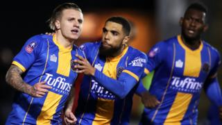 Jason Cummings celebrates scoring for Shrewsbury against Liverpool