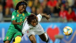 Gabrielle Aboudi Onguene of Cameroon battles for possession with Kadeisha Buchanan of Canada