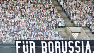Cardboard cutouts of Borussia fans