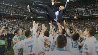 Zinedine Zidane celebrates winning the 2018 Champions League final with the Real Madrid players