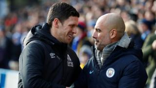 Manchester City manager Pep Guardiola shakes hands with Huddersfield Town caretaker manager Mark Hudson
