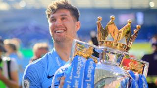 Manchester City defender John Stones with the Premier League trophy