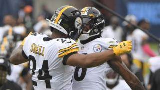 Benny Snell celebrates a touchdown with Pittsburgh Steelers team-mate Jaylen Samuels