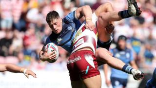 St Helens's Morgan Knowles in action with Wigan Warriors' Willie Isa