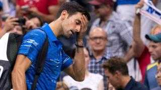 Novak Djokovic walks off court after retiring injured against Stan Warinka