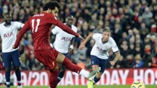 Mohamed Salah scoring a penalty against Tottenham Hotspur