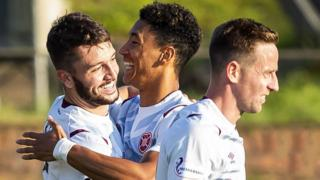 Craig Halkett (left) opens Hearts account