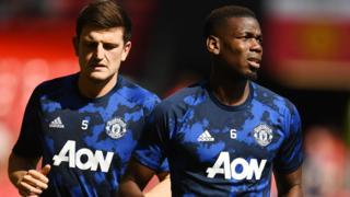Manchester United's Harry Maguire and Paul Pogba