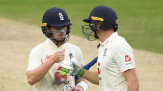 Jos Buttler & Ollie Pope punch gloves at the close of play