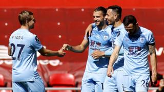 Jay Rodriguez (centre) celebrates scoring against Liverpool