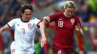 Ellen White of England is challenged by Marta Corredera