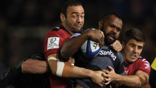 Vereniki Goneva of Newcastle Falcons runs with the ball as Mamuka Gorgodze of RC Toulon tries to bring him down