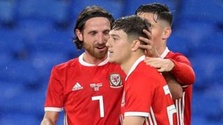 Joe Allen congratulates Daniel James
