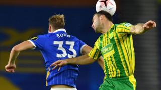 Brighton Dan Burn vies with West Bromwich Albion defender Branislav Ivanovic