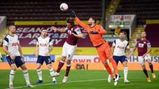 Tottenham goalkeeper Hugo Lloris punches clear