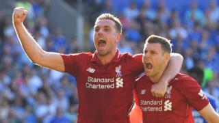 Milner and henderson celebrate