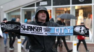 Scarf seller outside the stadium