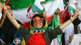 An Iranian woman cheers during the World Cup Qatar 2022 Group C qualification football match between Iran and Cambodia at the Azadi stadium in the capital Tehran on 10 October 2019.