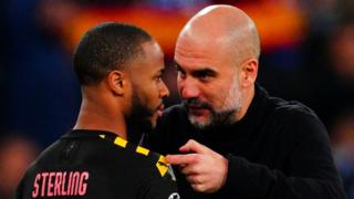 Manchester City manager Pep Guardiola and forward Raheem Sterling