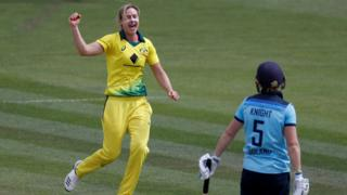 Australia's Ellyse Perry (left) celebrates taking the wicket of England captain Heather Knight (right)