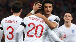 Callum Hudson-Odoi and Jadon Sancho celebrate a goal in England's 5-1 win over Montenegro