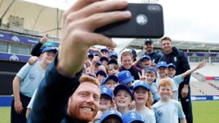 Jonny Bairstow takes a selfie with young cricket fans