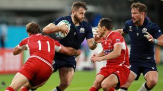 Tommy Seymour of Scotland is tackled by Vladislav Sozonov of Russia during the Rugby World Cup 201