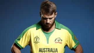 David Warner looks down in a photo shoot