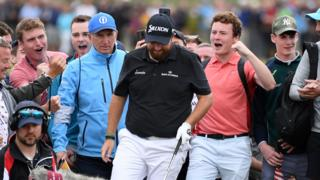 Supporters cheer on Shane Lowry during the Irishman's third round at The Open at Royal Portrush