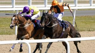 Zodiakos (right) and Al Ozzdi battle to the line in the opener at Newcastle