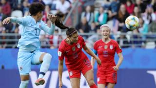Alex Morgan of the USA scores her team's first goal