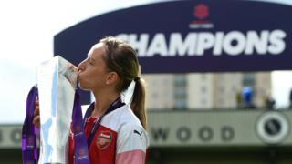 Jordan Nobbs holds the Women's Super League trophy
