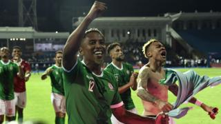 Madagascar players celebrate scoring at the Africa Cup of Nations