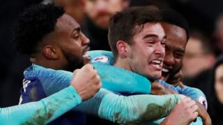 Harry Winks celebrates scoring for Tottenham