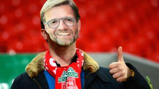 Liverpool fan with Jurgen Klopp mask