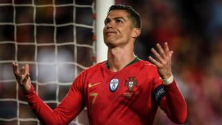 Cristiano Ronaldo gestures during Portugal's game with Serbia
