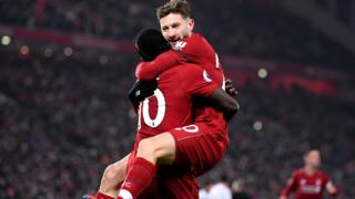 Sadio Mane and Adam Lallana celebrate