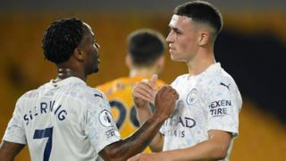 Phil Foden celebrates with Raheem Sterling