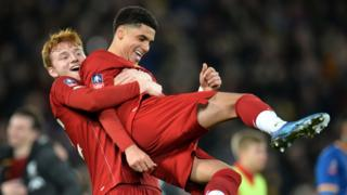 Liverpool's players celebrate beating Shrewsbury in the FA Cup