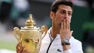 Novak Djokovic celebrates winning the Wimbledon men's singles title