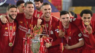 Liverpool's players celebrate with the Premier League trophy