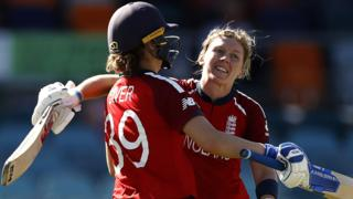 Heather Knight is hugged by Natalie Sciver after her century