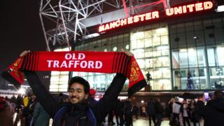 Manchester United fan outside Old Trafford