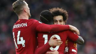 Mohamed Salah celebrates his opener for Liverpool with team-mates Sadio Mane and Jordan Henderson